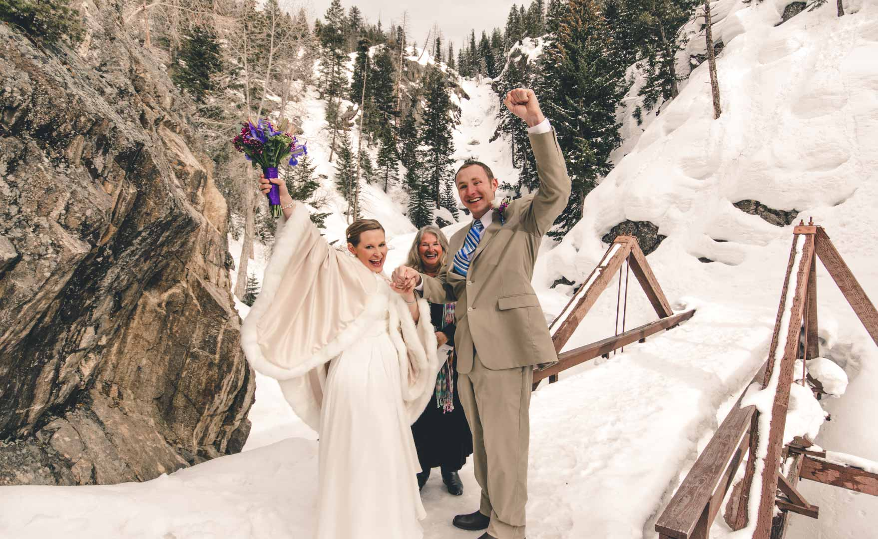 couple marrying outdoors at fish creek falls