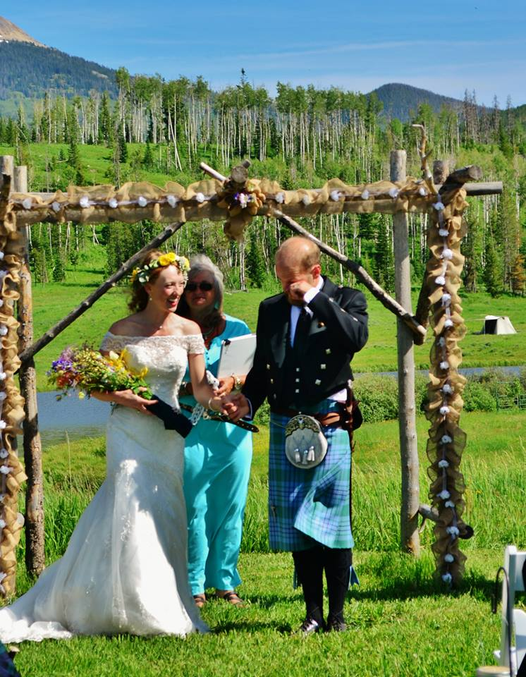 wedding couple with officiant